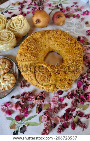 Traditional wedding bread with fruits and flowers on the table, Island of Crete, Greece