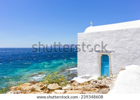 traditional white house with sea view in Mykonos island,Greece - stock photo