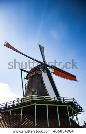 Traditional windmill in the Netherlands. Theme of ecology, traditions, national culture, tourism.