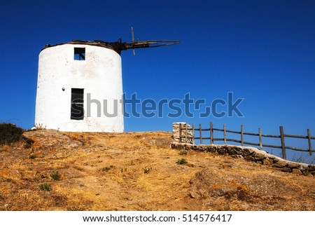 Traditional windmill in Tripodes (Vivlos) village on Naxos island, Greece