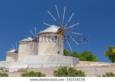 Traditional windmills in Alacati, Izmir province, Turkey - stock photo