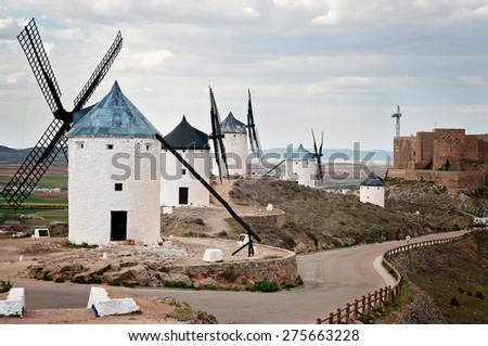 Traditional windmills in Don Quixote route in Consuegra, Toledo, Spain - stock photo