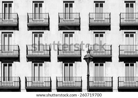 Traditional windows and balconies in Valladolid, Spain. Toned. - stock photo