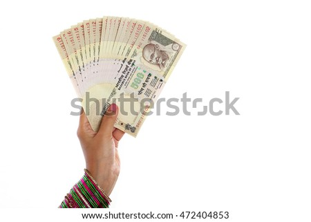 Traditional woman hand holding Indian currency