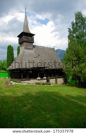 Traditional wood church from Romania. Romanian traditional architectural style, life in the countryside. Wood church monastery Dragoslavele - stock photo