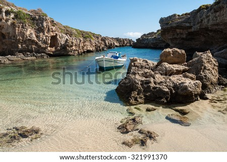 Traditional wooden boat in narrow gulf in Peloponnese, Greece - stock photo