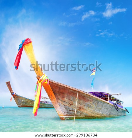 Traditional wooden boat in Thailand near Phuket island. Adventure trip background  - stock photo