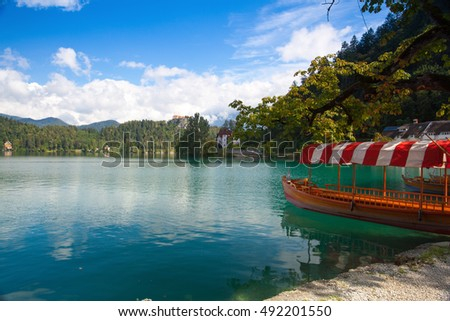 Traditional wooden boats at the pier of the Bled Island, Lake Bled, Slovenia.