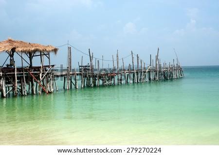 Traditional wooden bridge on the beach. - stock photo