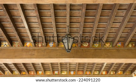 Traditional Wooden Ceiling Decorated by Numerous Coats of Arms - stock photo