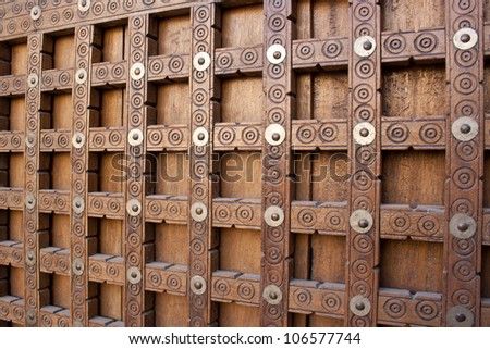 Traditional wooden door with decorations, Timbuktu, Mali, Africa.