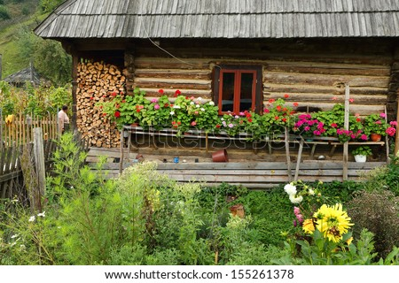 Traditional wooden house in Maramures, Romania - stock photo