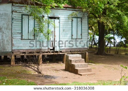Traditional wooden house of Creole people living on the Caribbean coast of Nicaragua. The Great Corn Island - stock photo