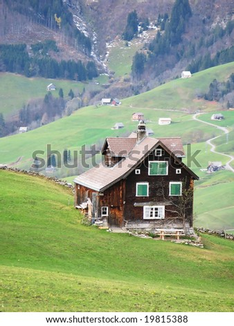 Traditional wooden house on a slope in Arvenbuehl, Switzerland