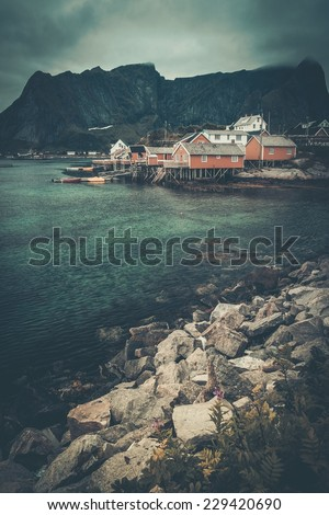 Traditional wooden houses in Reine village, Norway - stock photo