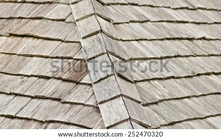 Traditional wooden roof tile of old house. - stock photo
