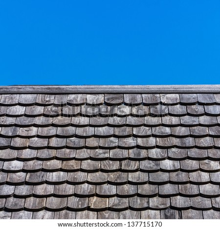 Traditional wooden roof tile with blue sky - stock photo