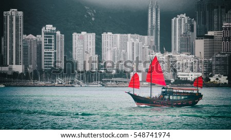 Traditional wooden sailboat sailing in victoria harbor hong kong island