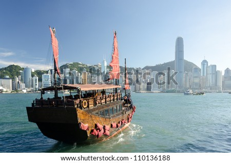 Traditional wooden sailboat / tourist junk sailing in Victoria Harbour ,Hong Kong - stock photo