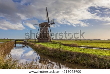 Traditional wooden windmill in Frisian countryside, Netherlands - stock photo