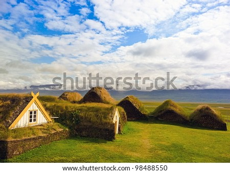 Traditional Yellow Iceland turfed roof housing with green grass - stock photo