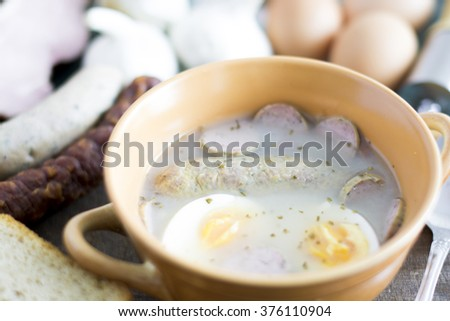 Traditional Zurek with sausage and egg, white borscht, polish Easter soup - stock photo