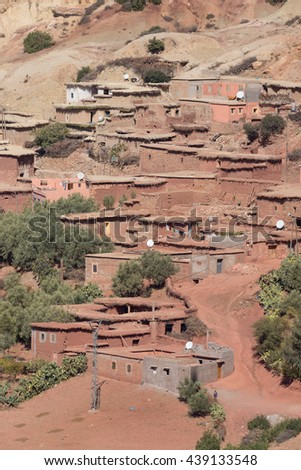 Traditionally built adobe house in the village in the Atlas Mountains, Morocco - stock photo