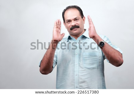 Traditionally dressed Indian man with a conversation gesture - stock photo