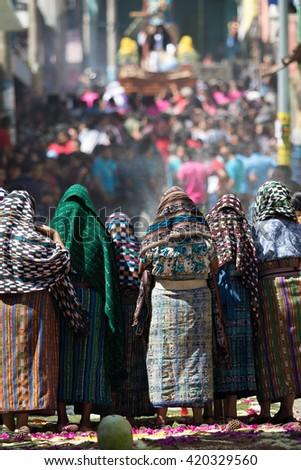 traditionally dressed mayan tzutujil women on the street at holy - stock photo