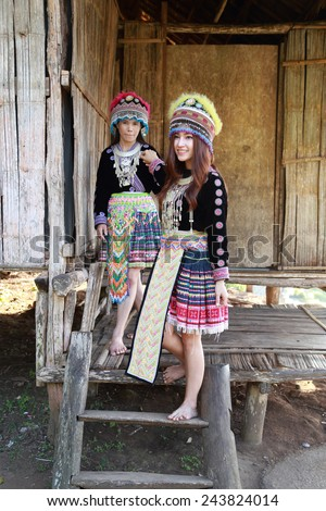 Traditionally dressed Mhong hill tribe woman in the wooden cottage - stock photo