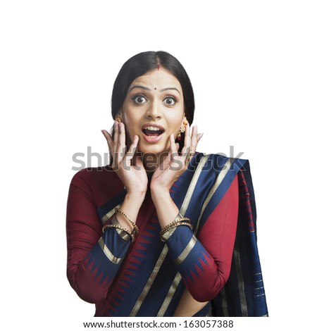 Traditionally Indian woman looking surprised - stock photo