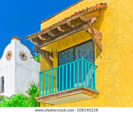 Traditionally looking  balcony in colorful caribbean, mediterranean city.
