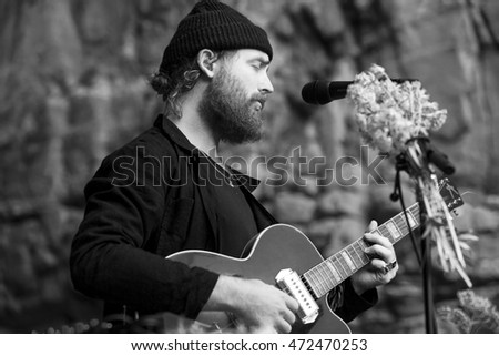 Traena, Norway - July 09 2016: Concert of Australian singer-songwriter and musician Ry X at cathedral cave of Kirkehelleren on Sana Island at the Traena music festival