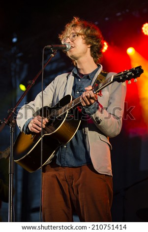 Traena, Norway - July 11 2014: concert of the Norwegian singer and guitarist Erlend Oye with the Icelandic band Hjalmarat the Traenafestival, music festival taking place on the small island of Traena