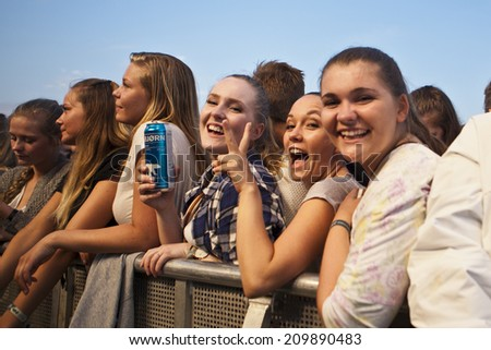 Traena, Norway - July 11 2014: people watching the concert of the Swedish pop-techno band Den Svenska Bjornstammen at the Traenafestival, music festival taking place on the small island of Traena