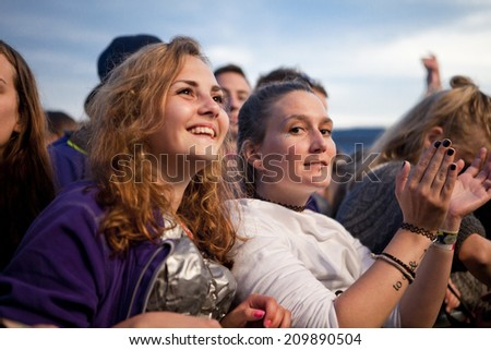Traena, Norway - July 11 2014: people watching the concert of the Swedish pop-techno band Den Svenska Bjornstammen at the Traenafestival, music festival taking place on the small island of Traena - stock photo