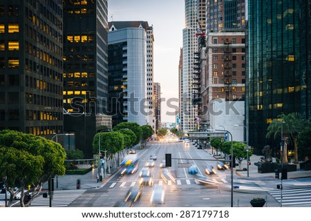 Traffic and buildings on Figueroa Street, in the Financial District, Los Angeles, California. - stock photo