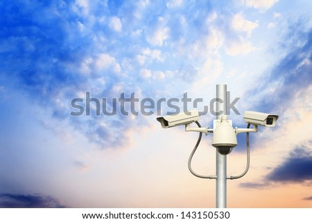 traffic cameras with sunset background
