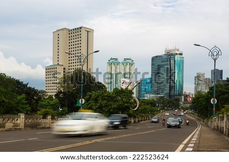 Traffic captured with blurred motion along Rasuna Said street in Jakarta's Kuningan district - stock photo