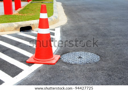 Traffic cone on car park - stock photo