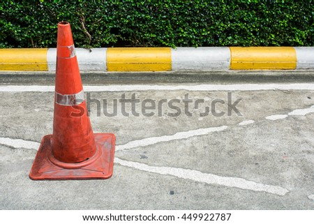 Traffic cone on no parking sign