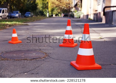 Traffic cone on road - stock photo