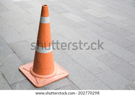 Traffic cone on the road. - stock photo