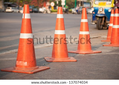 Traffic cone placed on the road. Not to be allowed to park in this area. - stock photo