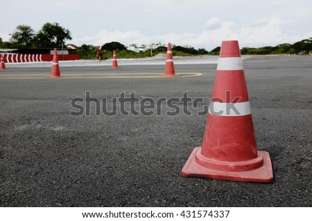 Traffic cone, road safety cone in racing circuit
