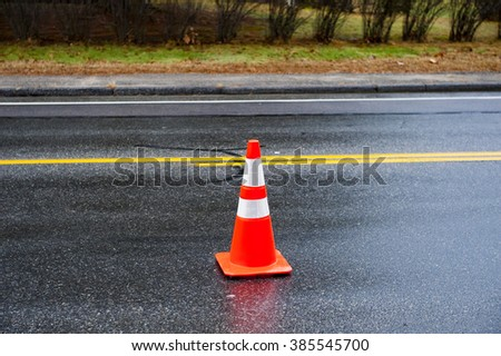 Traffic cone warns drivers of unusual road conditions