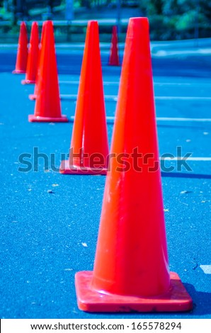 Traffic cones in empty parking space - stock photo