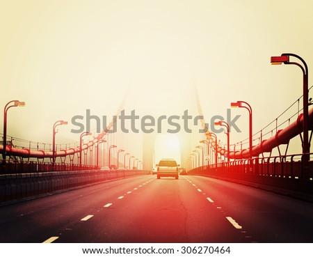 Traffic crossing a foggy Golden Gate Bridge in San Francisco - stock photo