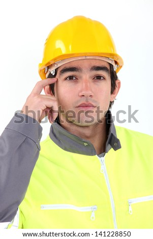 Traffic guard scratching his head - stock photo