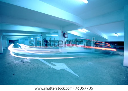 traffic in car park with blue toned - stock photo